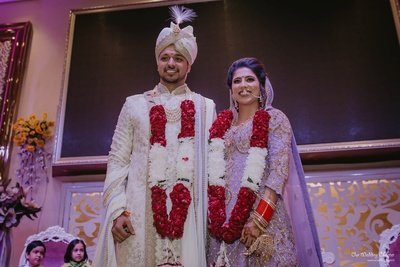 The couple pose after completing the wedding rituals