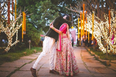 Shravan complementing her in  dark brown velvet bandhgala jacket with white jodhpuri pants styled with brown shoes for the sangeet ceremony.