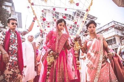 Pink wedding lehenga embellished with zari embroidery motifs by Div'ani Clothing Store