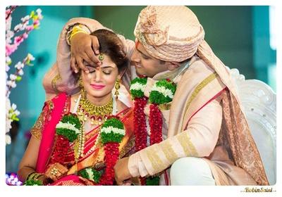 Wedding sherwani styled with a matching blush safa