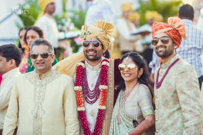 Groom posing with family members