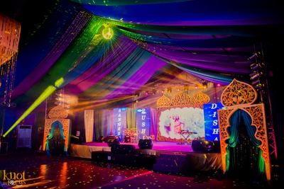 Moroccan style stage decor with cut-out frames and LED screen