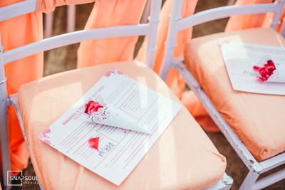 Wedding ceremony favours included rose petals for the pheras.
