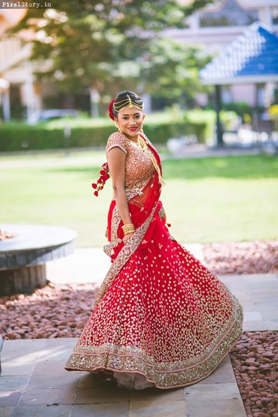 Our bride looking flawless in this beautiful red and golden bridal lehenga by Sabyasachi