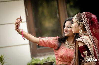 Bride and bridesmaids take selfies and photos before the wedding function