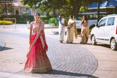 Beautiful bride walking towards the venue at her wedding day