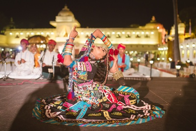Traditional Rajasthani folk dancers dresed in authentic attires, performing to entertain the guests