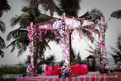 Mandap floral decor done for an outdoor area with beach backdrop