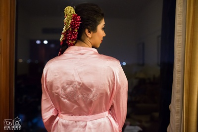 Dressed in a personalized bridal robe for her big day