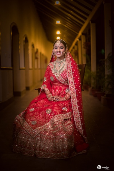 bridal portrait in a red lehenga