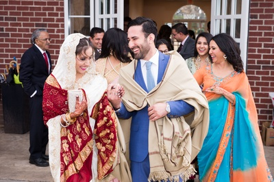 The bride and groom looking absolutely blissful post their wedding ceremony!