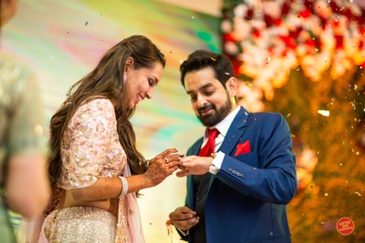 Bride and groom exchange rings during the sangeet ceremony