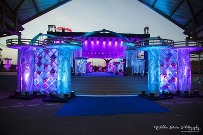 Venue entrance with artistic white pillars and chequered flower stands