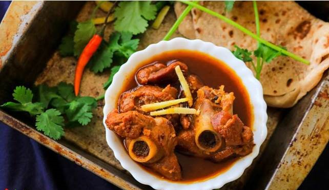 Lamb Rogan Josh is a Kashmiri dish which is served with rice or naan.