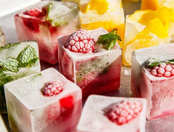 INFUSED ICE CUBES Freezing ice cubes with your choice of fruits or any other item.