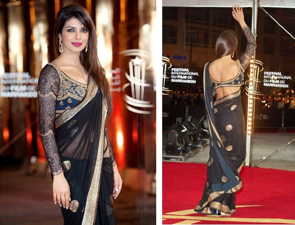6e3395f9807ee9 Priyanka wore this black net saree to the Marrakech Film Festival. We're in  love with that intricate net sleeve and the pattern on the blouse!