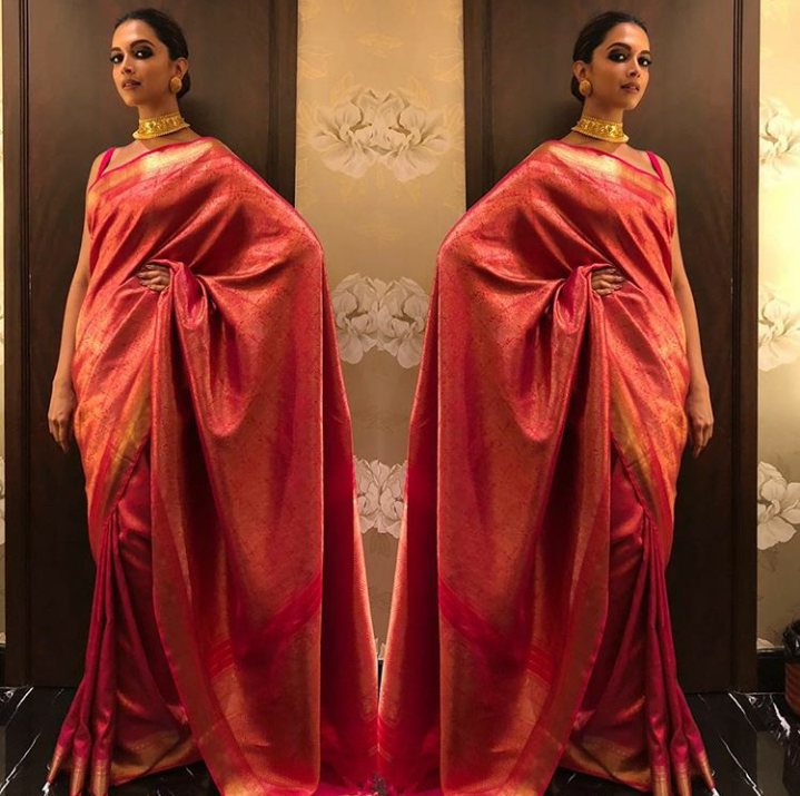 6. Hello beautiful! The bold pink banarasi saree paired with gold jewelery and smokey eyes is making us swoon!