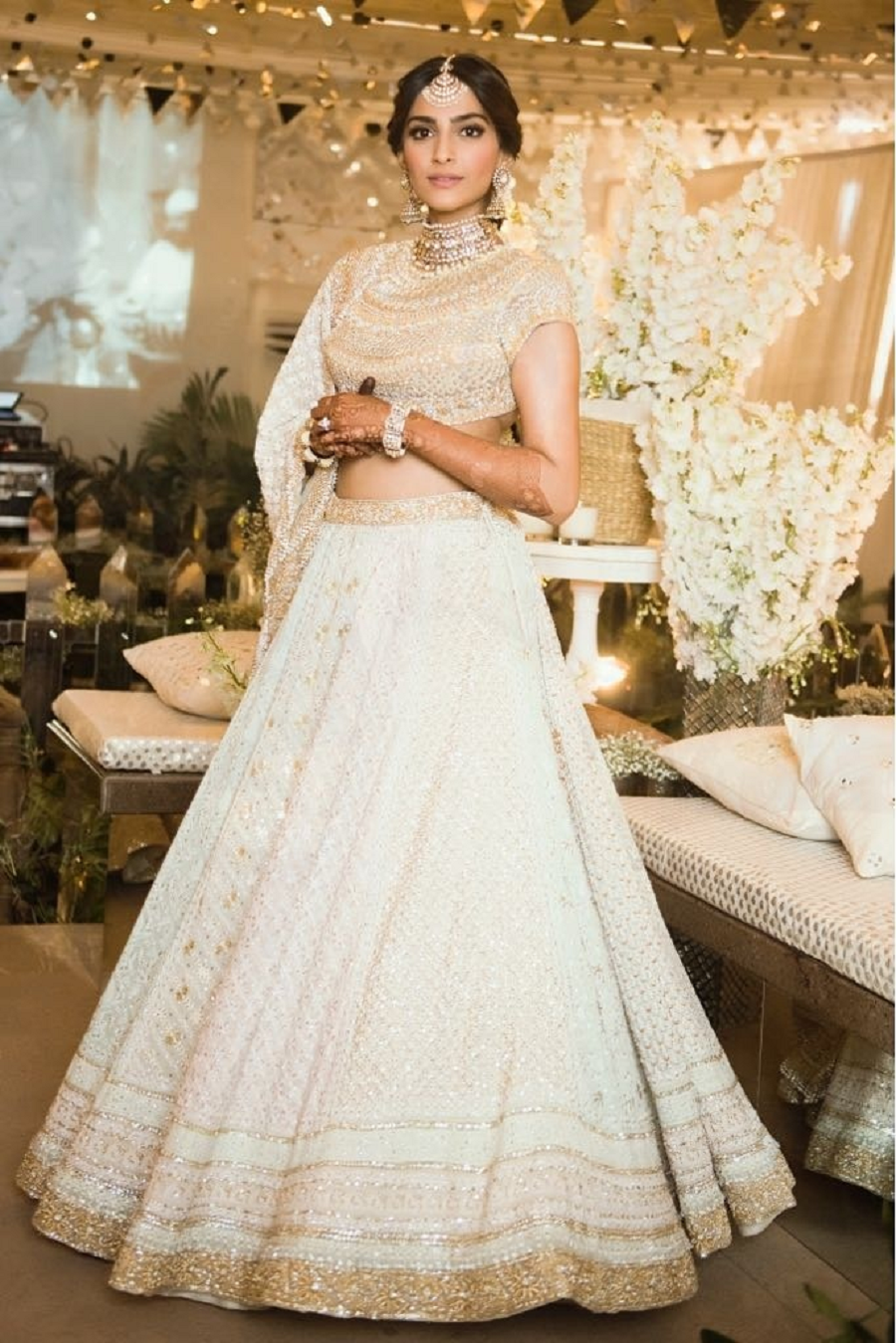 f6a0fdf90 Sonam Kapoor made headlines when she chose to wear this stunning ivory &  gold chikankari Abu Jani and Sandeep Khosla lehenga for the her sangeet and  mehendi ...